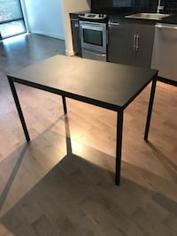 rectangular black wooden table with black metal base Washington, 20004