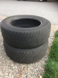 Two black rubber car tires Surrey, V3V 5R1