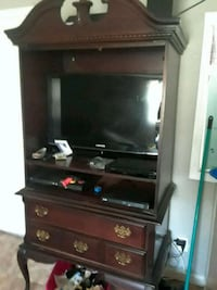 brown wooden TV hutch with flat screen television 555 mi