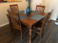 rectangular brown wooden table with four chairs dining set New Port Richey, 33556