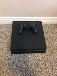 black Sony PS4 console with controller Nashville
