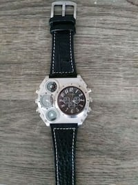 round silver chronograph watch with black leather  Los Angeles, 90003