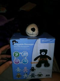 black Huggable massager box 2272 mi