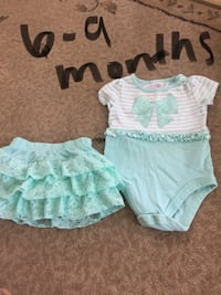 baby girl's white and teal onesie with tiered skirt