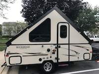white and black RV trailer Sterling, 20166