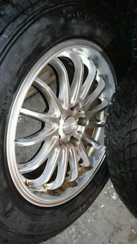 chrome multi-spoke car wheel with tire 592 km