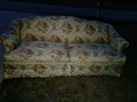 brown and white floral fabric 2-seat sofa