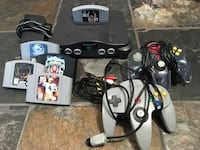 black Nintendo 64 console with controllers and game cartridges Corona, 92882