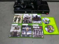 black Xbox One console with controller and game cases Newport, 41071