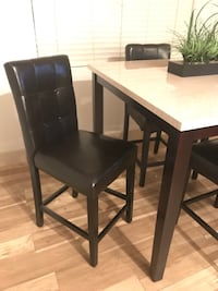 white and brown wooden table and chairs set