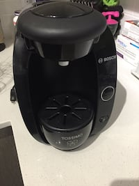 Tassimo coffee maker and pod holder