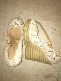 pair of white leather flats Toronto, M6S 1M8