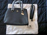 COACH black purse w/strap with gift bag never used in new condition.  Catasauqua, 18032