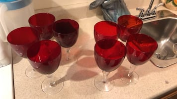 Two red and black glass candle holders