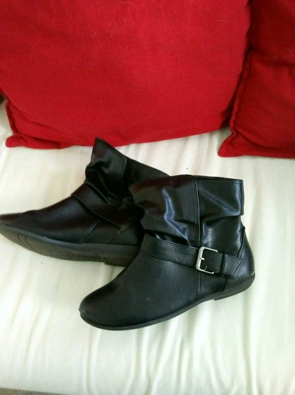 Pair of black leather ankle boots