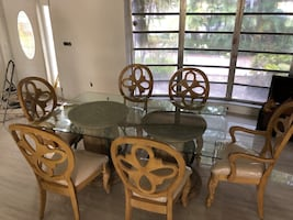 Glass table with base and six chairs