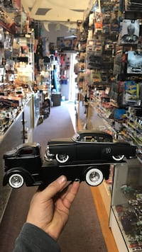 classic black pickup truck and coupe die-cast scale models