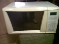 white and black microwave oven null