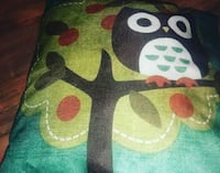 green, black, and red floral textile