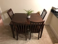 rectangular brown wooden table with four chairs dining set Alexandria, 22314