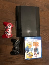 black Sony PS3 super slim console with controllers and game 544 km