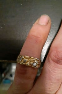 Gold plated ring with a cubic zirconium diamond