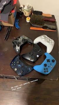 Xbox one with black and white controllers Baltimore, 21213