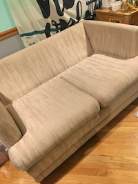 Beige mid sized loveseat