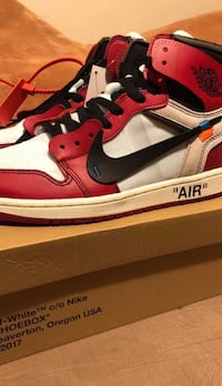 unpaired red and white Nike Air Jordan 1 shoe New York, 10458