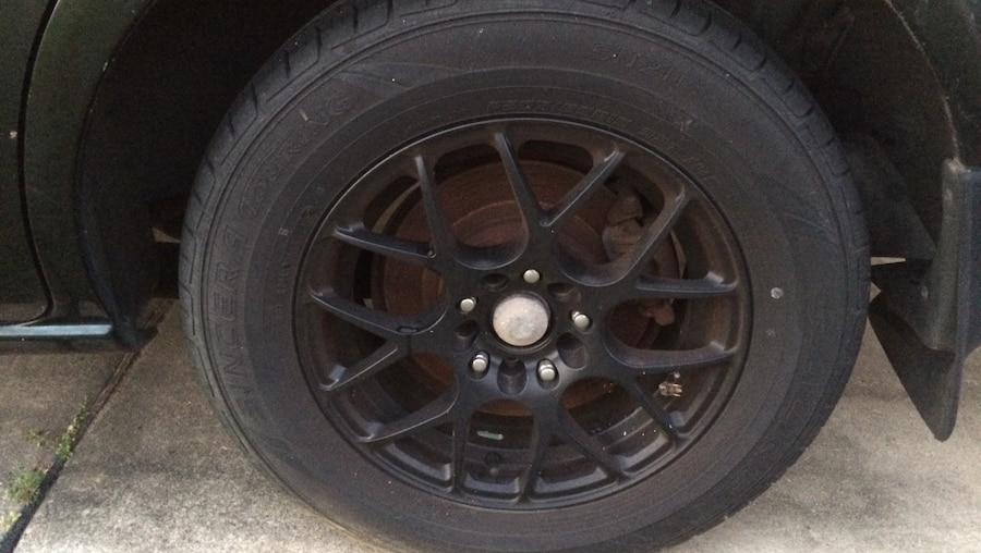 Used Black 5-stud auto rims with tire in Milton