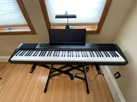 Casio Digital Piano plus stand, light, and cover