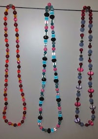 three blue, red, and white beaded necklaces 1213 mi