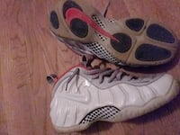 white-and-gray Nike Air Foamposite Pro shoes