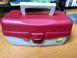 Fishing tackle box with lots of new lures.