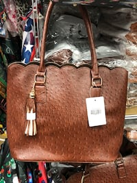 brown leather tote bag with fringe 1145 mi