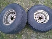 two chrome auto wheels with tires Houston, 77068