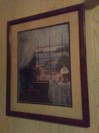 window, table, and chair painting with brown wooden frame