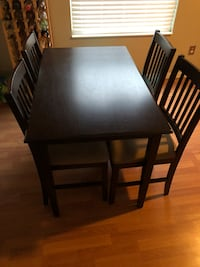 rectangular brown wooden table with four chairs dining set Columbus, 43026