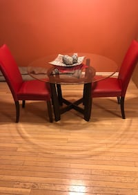 Ashley's Round glass table with two red chairs. In good condition! Centreville, 20121