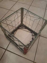 Old wire milk crate.