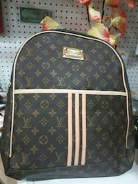 monogrammed brown Louis Vuitton leather backpack Montréal, H4N 2N6