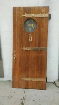 brown wooden 2-panel door 36*83