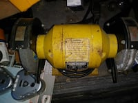 yellow and black bench grinder