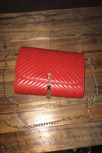 Red leather purse with gold shoulder strap