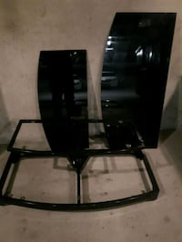 Black glass Tv Table priced for sale.  Airdrie