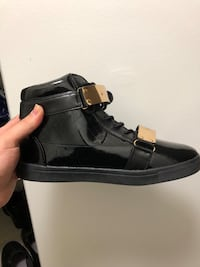 Unpaired black leather shoe