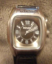 nixon silver square analog watch with black leather straps Parksville, V9P