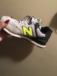 white, green, and black New Balance running shoes