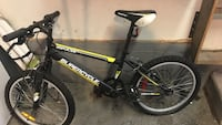 black and red Mongoose hardtail mountain bike