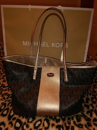 women's monogrammed black and gray Michael Kors leather tote bag with paper bag